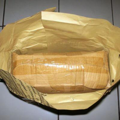 Kardus paket Dinomarket - buka kertas pembungkus