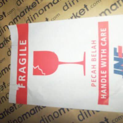 """Paket kiriman JNE dari Dinomarket - stiker """" barang pecah belah(fragile)"""""""